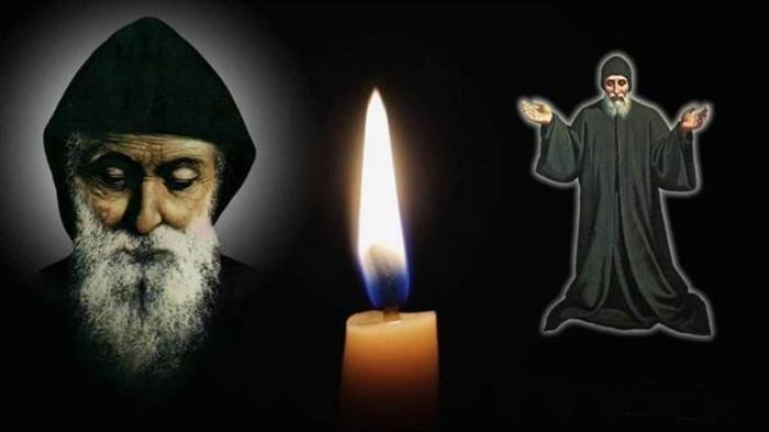 святому Шарбелю фото со свечей
